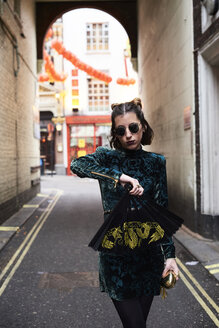 London, young woman with chinese fan in Chinatown - IGGF00765