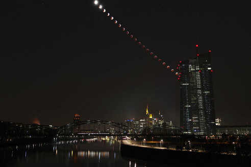 Germany, Hessen, Frankfurt am Main, composite sequence of total lunar eclipse of January 21, 2019 facing ECB tower and city skyline - THGF00075