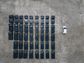 Indonesia, Bali, Aerial view of car park, one white car next to black - KNTF02628