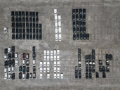Indonesia, Bali, Aerial view of car park, black and white - KNTF02634
