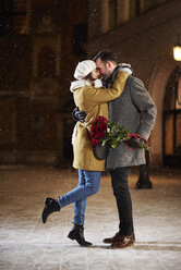 Couple in love hugging in the city in winter - ABIF01163