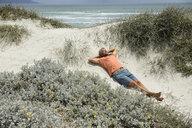 South Africa, man lying at Bloubergstrand - ECPF00373