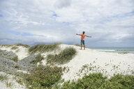 South Africa, man raising arms at Bloubergstrand - ECPF00376