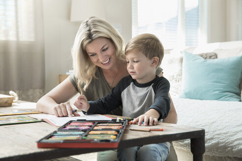 Mother and son coloring in living room - HEROF19023