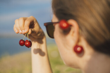 Woman's hand holding cherries - JSCF00139