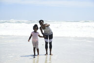 Mother with daughter on the beach - ECPF00402