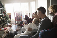 Family taking selfie with digital tablet in Christmas living room - HEROF19476