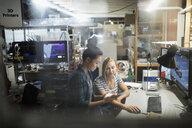 Female engineers using digital tablet in workshop - HEROF19677