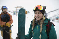 Happy, confident female skier in snow - HEROF20628