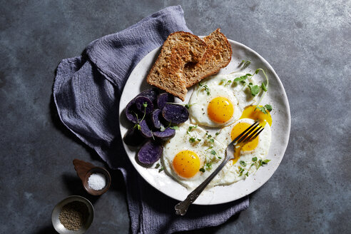 Breakfast plate of eggs and toast, overhead view - CUF48625