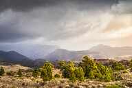 Landscape with distant mountains and storm clouds, Mogan, Canary Islands, Spain - CUF48775