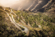Winding mountain road (GC-605) from Mogán into mountains. South west coast of Gran Canaria, Mogan, Canary Islands, Spain - CUF48781