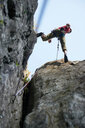 Rock climber jumping over rocks, Chamonix, Rhone-Alps, France - CUF48910