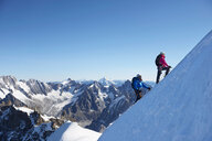 Mountain climber on snowy slope, Chamonix, Rhone-Alps, France - CUF48928