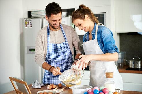 Couple baking in kitchen - CUF49120