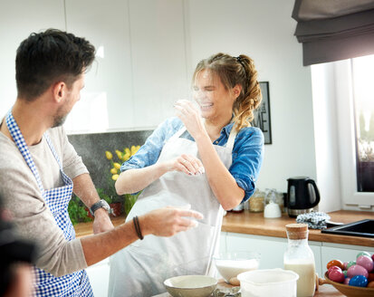 Couple playing with flour in kitchen - CUF49123