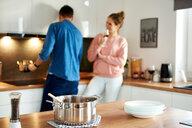 Couple talking in kitchen - CUF49126