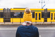 Woman looking at tram passing by, Budapest, Hungary - CUF49168