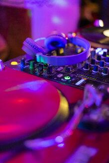 Headphones on illuminated mixing board - AFVF02350