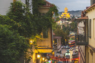 Georgia, Tbilisi, view from the old town on Sameba cathedral at dusk - KEB01093