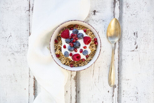 Bowl of muesli with Greek yogurt, popped quinoa, raspberries, blueberries and pomegranate seed - LVF07767