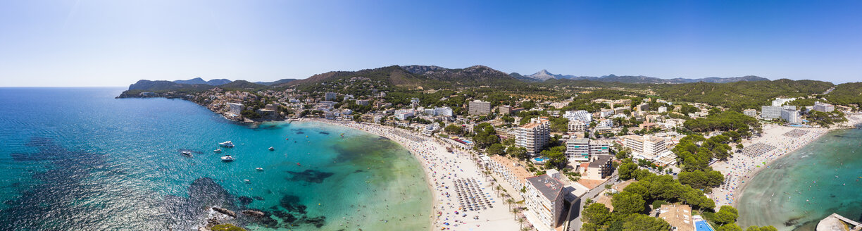 Spain, Balearic Islands, Mallorca, Region Calvia, Costa de la Calma, Peguera, Aerial view of beach with hotels, panorama - AMF06784