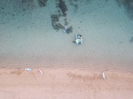 Sailboat,kayaks and sup boards at the beach, Nusa Dua,Bali,Indonesia - KNTF02644