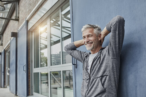 Portrait of laughing mature man in front of gym - RORF01735