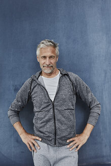 Portrait of mature man standing in front of gym - RORF01738