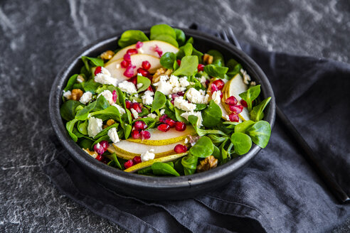Bowl of mixed salad with lamb's lettuce, feta, pear, pomegranate seed and walnuts - SARF04105