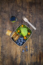 Lunch box of leaf salad, avocado, blueberries, tomatoes and crackers - LVF07777