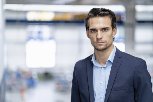 Portrait of confident businessman in a factory - DIGF05641
