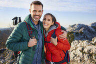 Portrait of happy couple on a hiking trip in the mountains - BSZF00935