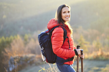 Portrait of smiling woman on a hiking trip in the mountains - BSZF00980