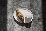 Cup of white coffee and a whole meal croissant on plate - AFVF02352