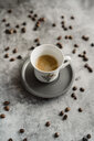 Cup of espresso and scattered coffee beans - AFVF02355