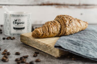 Whole meal croissant with grains on wooden board - AFVF02361