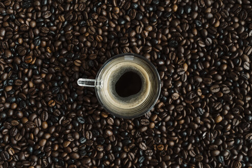 Glass of black coffee between coffee beans - AFVF02379