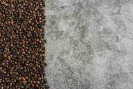 Coffee beans on grey marbled background - AFVF02382