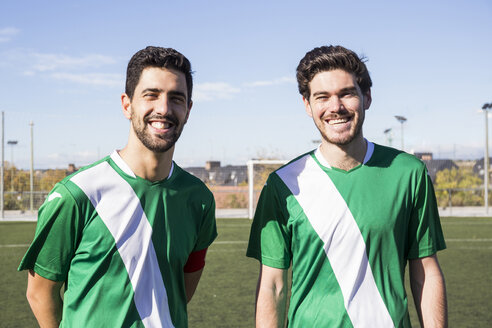 Portrait of two confident football players on football field - ABZF02181