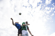 Football players jumping to head the ball during a football match - ABZF02193