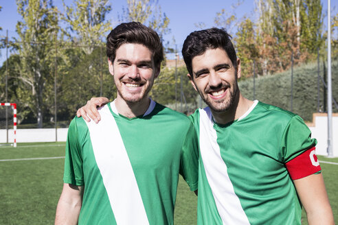Portrait of two confident football players on football field - ABZF02223