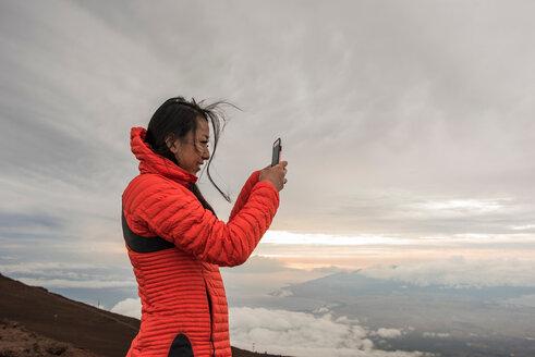 Woman taking photograph, Haleakala National Park, Maui, Hawaii - ISF20775