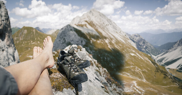 Austria, Tyrol, point of view shot of man's legs in mountainscape - FKF03259