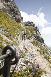 Austria, Tyrol, woman on a hiking trip in the mountains - FKF03298