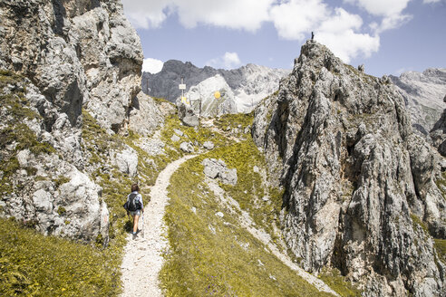 Austria, Tyrol, woman on a hiking trip in the mountains - FKF03301