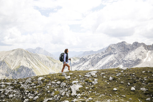 Austria, Tyrol, woman on a hiking trip in the mountains - FKF03310