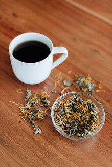Mug of herbal tea and tea leaves - ISF20908