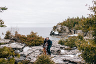 Couple by seaside, Tobermory, Canada - ISF20938