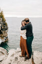 Couple by seaside, Tobermory, Canada - ISF20941